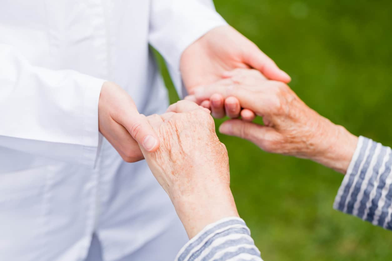 Young carer giving helping hands for elderly woman. home health care in San Antonio concept